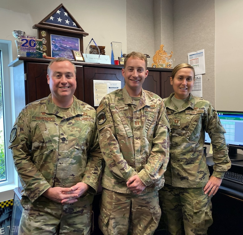 From left, Lt. Col. Steven Fletcher, 325th Contracting Squadron commander, Capt. Sean Murphy, 325th Civil Engineer Squadron deputy engineering flight chief, and Captain Meara McCarthy, 325th Comptroller Squadron budget officer, successfully allocated approximately $1 billion for Tyndall AFB during the final quarter of FY19.
