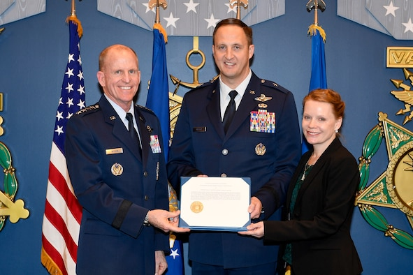 Air Force Vice Chief of Staff Gen. Stephen Wilson poses with Brig. Gen. Julian Cheater and his wife, Camila Cheater, during a ceremony to present the couple with the 2018 General and Mrs. Jerome F. O'Malley Award at the Pentagon in Arlington, Va., Nov. 13, 2019. The award annually recognizes a wing commander and his or her spouse who together best exemplify the ethos of Airmen-centric service. (U.S. Air Force photo by Andy Morataya)