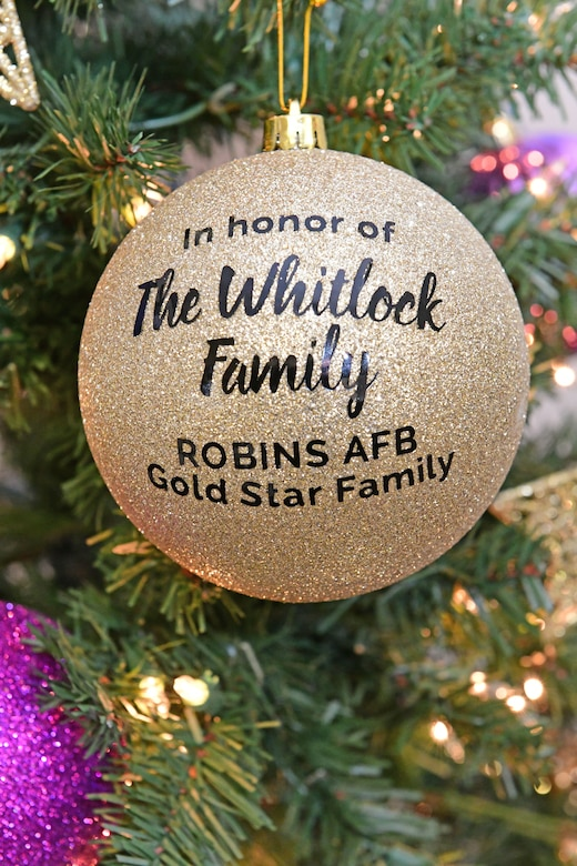 Picture shows a Gold Star family ornament on the Gold Star Holiday Tree for the Whitlock Family, a Gold Star family at Robins AFB.