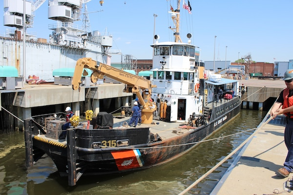 The Coast Guard Cutter Smilax (WLIC 315) arrived at the Coast Guard Yard in Baltimore, May 4, 2015, to begin an anticipated 15-week repair availability for overhaul, inspection, and preservation work on the 71-year-old, 100-foot inland construction tender. (USCG photo by Charles Wilson, Yard)