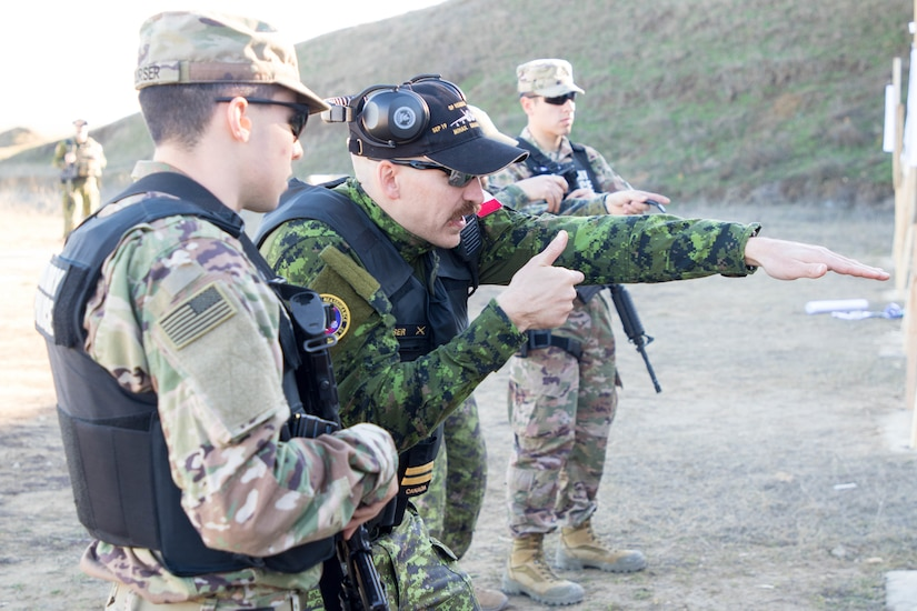 U.S. and Canadian military police conduct weapons training in Romania