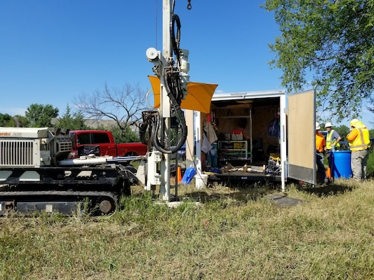 The membrane interface and hydraulic profiling tool (MiHPT) rig. Multiple probes are submerged approximately 100 feet below ground while real-time data is monitored within the trailer.