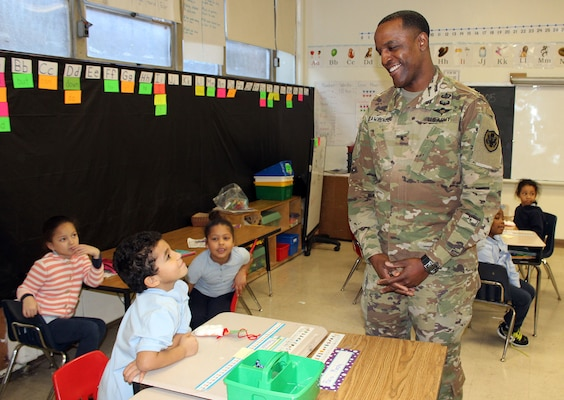 DLA Troop Support Commander Army Brig. Gen. Gavin Lawrence talks with students during the annual Children's Holiday Party Dec. 12, 2019 in Philadelphia.