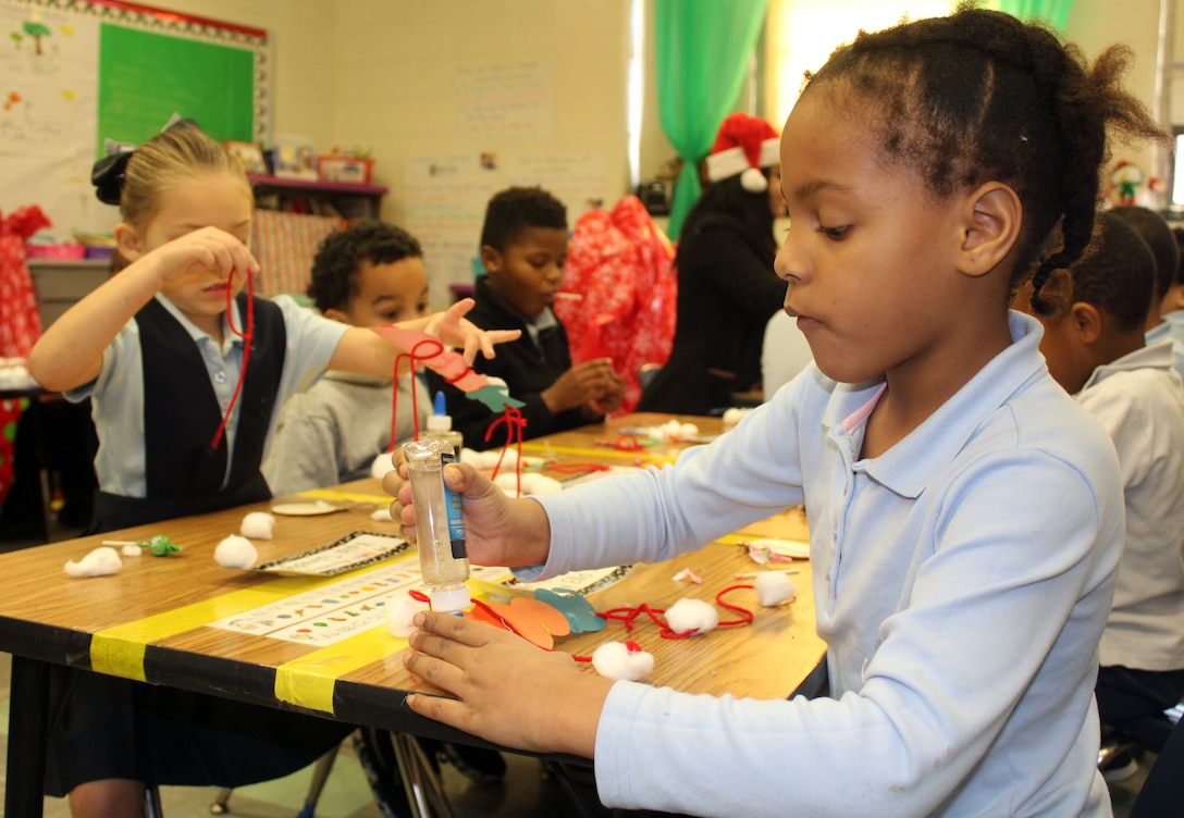 Benjamin Franklin Elementary School students make ornaments during the DLA Troop Support Children's Holiday Party Dec. 12, 2019 in Philadelphia.