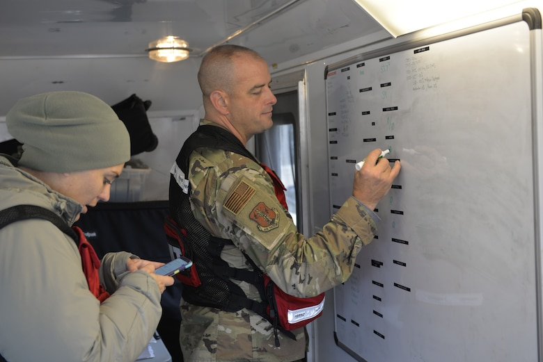 Airman 1st Class Jaylin Acres and Chief Master Sgt. Shawn Therberge, 157th Medical Group, Detachment 1, N.H. Air National Guard, gather data for work rest cycles, including food water temperature during a New England CERFP training exercise, Nov. 5, 2019, Brunswick, Maine. The week-long exercise enable the guardsmen to hone their medical response skills. (U.S. Air National Guard photo by Tech. Sgt. Aaron Vezeau)