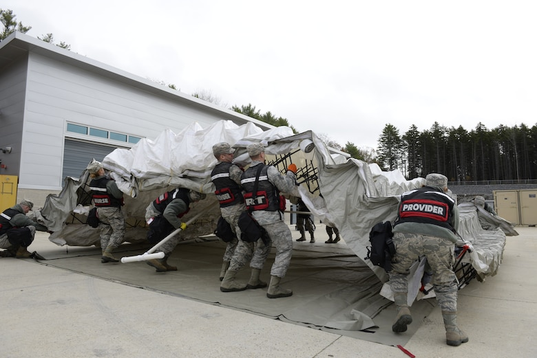 Airmen with the 157th Medical Group, Detachment 1, setup a mobile medical tent during a New England CERFP mass casualty training exercise, Nov. 5, 2019, Brunswick, Maine. The exercise simulated the collapse of a chemical manufacturing building. (U.S. Air National Guard photo by Tech. Sgt. Aaron Vezeau)