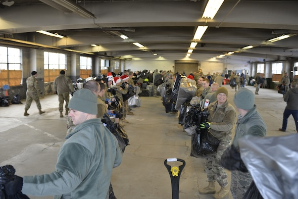 N.H. National Guardsmen help load donated Christmas gifts as part of Operation Santa Claus on Dec. 16 in Concord. Volunteers from the State Employees' Association, SEIU Local 1984, partner with N.H. guardsmen annually to transport presents to distribution points throughout the state. The program has been led by the SEA since 1960, and ensures gifts are provided to thousands of NH children in need. (U.S. Air National Guard photo by Tech. Sgt. Aaron Vezeau)