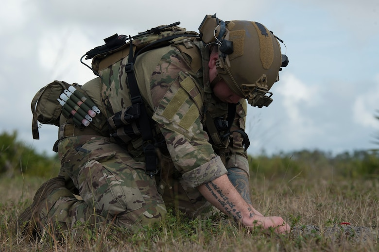 U.S. Air Force Staff Sgt. Taylor Lahteine, a 6th Civil Engineer Squadron explosive ordnance disposal (EOD) flight technician, works to secure a simulated explosive device during a field training exercise, Dec. 11, 2019, at Avon Park Air Force Range, Fla.  The MacDill EOD flight conducted training simulations for detecting and securing improvised explosive devices to prepare for real-world deployment operations.
