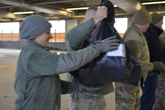 Staff Sgt. Kellie Daly helps load donated Christmas gifts as part of Operation Santa Claus on Dec. 16 in Concord. Volunteers from the State Employees' Association, SEIU Local 1984, partner with N.H. guardsmen annually to transport presents to distribution points throughout the state. The program has been led by the SEA since 1960, and ensures gifts are provided to thousands of NH children in need. (U.S. Air National Guard photo by Tech. Sgt. Aaron Vezeau)
