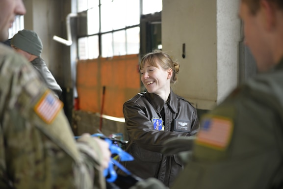 Staff Sgt. Shenna Londoff with the 157th Operations Group, New Hampshire Air National Guard, helps load donated Christmas gifts as part of Operation Santa Claus on Dec. 16 in Concord. Volunteers from the State Employees' Association, SEIU Local 1984, partner with N.H. guardsmen annually to transport presents to distribution points throughout the state. The program has been led by the SEA since 1960, and ensures gifts are provided to thousands of NH children in need. (U.S. Air National Guard photo by Tech. Sgt. Aaron Vezeau)