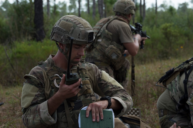 U.S. Air Force Staff Sgt. Phillip Wise, a 6th Civil Engineer Squadron explosive ordnance disposal (EOD) flight technician, uses a radio to call for a medical evacuation team during a field training exercise Dec. 11, 2019, at Avon Park Air Force Range, Fla. Wise conducted procedures to call for a medical evacuation team for simulated casualties during the training exercise.