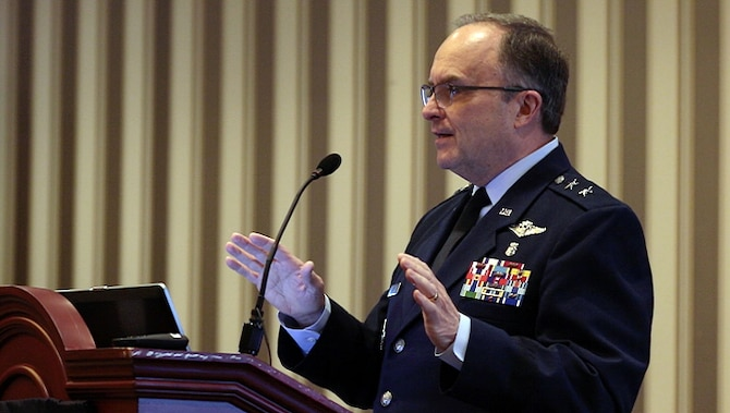 U.S. Air Force Maj. Gen. (Dr.) Lee Payne, director for Combat Support at the Defense Health Agency, discusses the transformative effects of MHS GENESIS, the Department of Defense's new electronic health record, during the 2019 Society of Federal Health Professionals' annual meeting in National Harbor, Maryland. Payne explained that the new electronic health record will ensure high quality care for patients while protecting the safety and security of patient information. MHS GENESIS will deploy in phases to all DoD military treatment facilities by 2023. (Defense Health Agency photo)