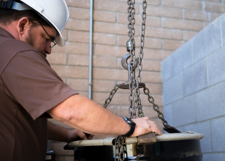 Carl Moser, 56th Civil Engineer Squadron environmental program manager, weighs a hazardous material drum Dec. 16, 2019, at Luke Air Force Base, Ariz.