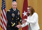 Amy Levine, analyst for DCTC, poses with Lt. Gen. Robert Ashley Jr. as she accepts the DIA Award for Meritorious Civilian Service