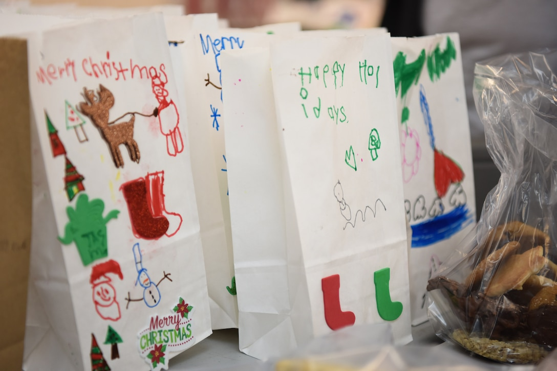 Bags decorated by students from local schools are used during the 2019 Cookie Drive Dec. 16, 2019, at Vandenberg Air Force Base, Calif. The Cookie Drive is an annual event held by the Spouse's Club at VAFB, where they deliver cookies to Airmen across the base.  (U.S. Air Force photo by Airman 1st Class Hanah Abercrombie)