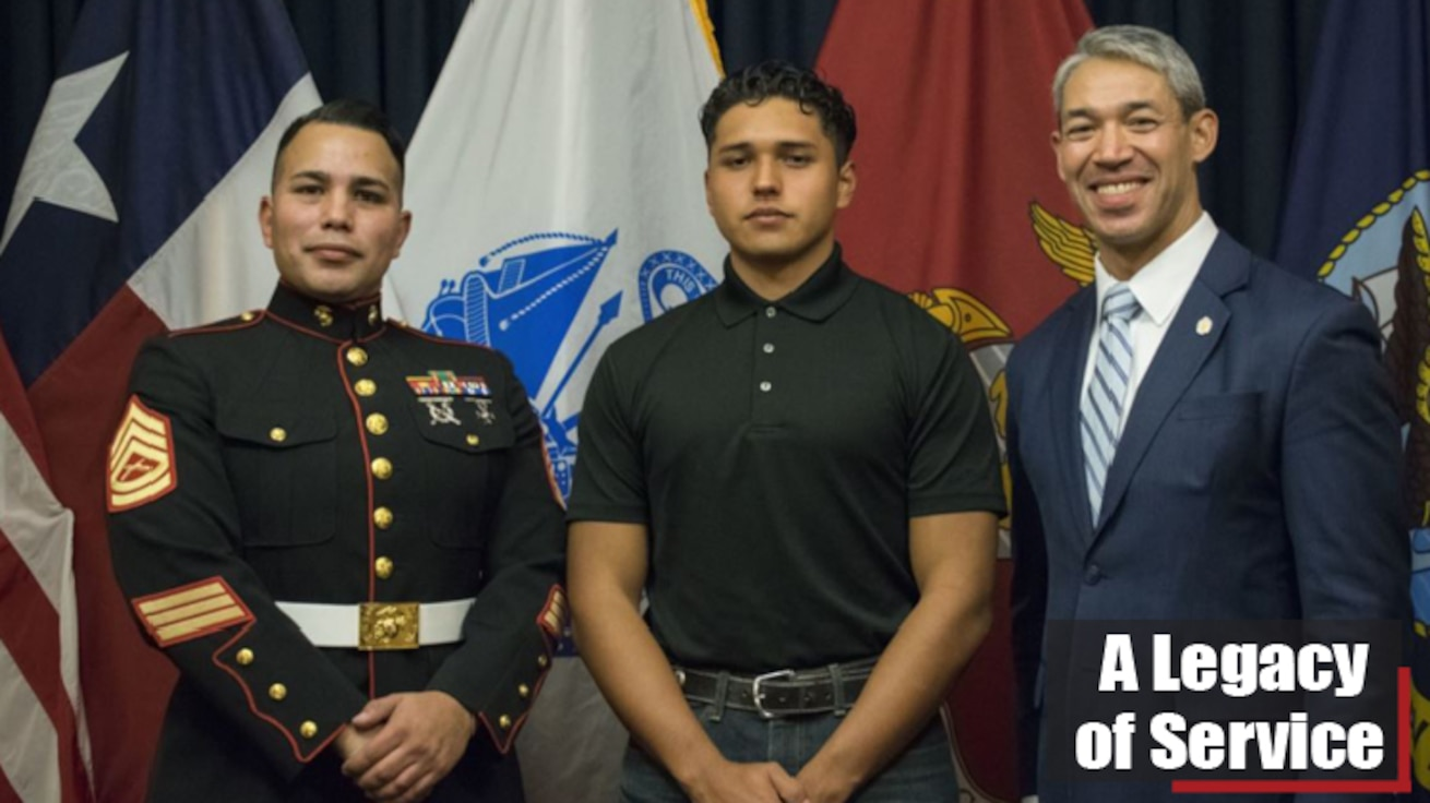 Julio Garcia, center, an enlistee in the U.S. Marine Corps, celebrates with Marine Gunnery Sgt. Angel Gonzalez, a recruiter with Recruiting Station San Antonio, and Ron Nirenberg, the mayor of San Antonio, following his enlistment ceremony at Joint-Base San Antonio Fort Sam Houston, Texas, on Dec. 10, 2019. Nirenberg attended the enlistment ceremony to support his nephew, Garcia, in his decision to join the Marine Corps.