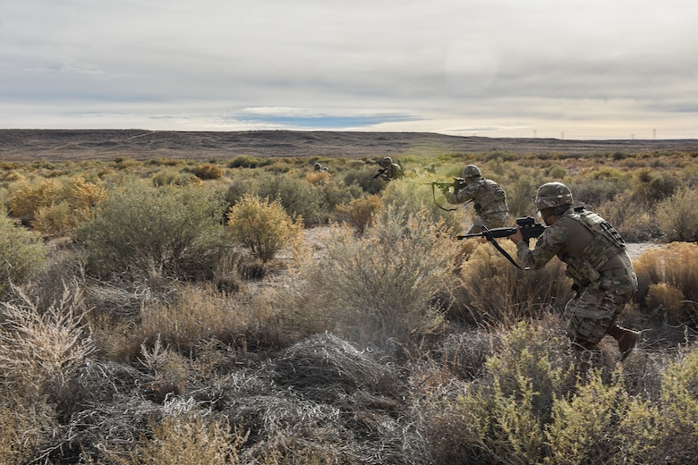 Security forces members advanced towards opposing forces during training.
