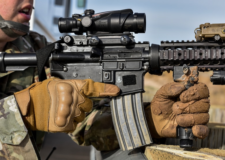 A security forces member holds his weapon.