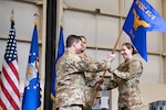 Lt. Col. Mary Clark takes the Detachment 7 guidon from Brig. Gen. Andrew Gebara during the assumption of command ceremony at Duke Field, Fla., Dec. 18, 2019. The new Air Force Global Strike Command unit is responsible for testing and evaluating the MH-139A, the first acquisition for the command. (U.S. Air Force photo/Sam King Jr.)