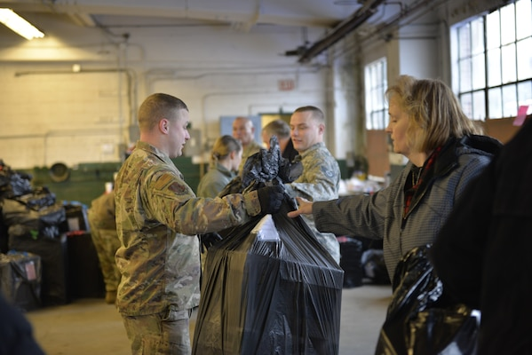 Brothers Tech. Sgt. Sean Wood and Staff Sgt. Christopher Wood, with the N.H. Air National Guard, help load donated Christmas gifts as part of Operation Santa Claus on Dec. 16 in Concord. Volunteers from the State Employees' Association, SEIU Local 1984, partner with N.H. guardsmen annually to transport presents to distribution points throughout the state. The program has been led by the SEA since 1960, and ensures gifts are provided to thousands of NH children in need. (U.S. Air National Guard photo by Tech. Sgt. Aaron Vezeau)