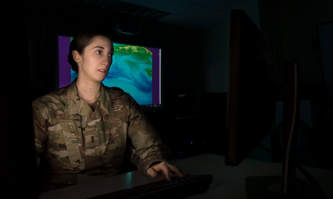 Photo of an Airman looking at a computer screen