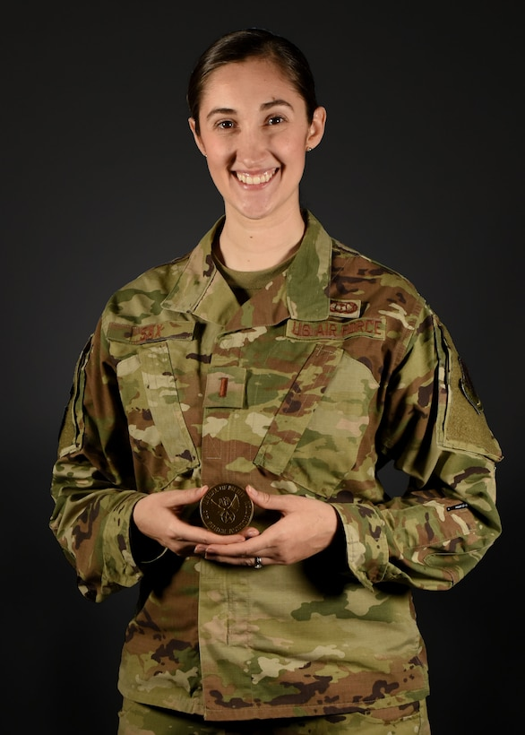 Photo of an Airman standing with a medal