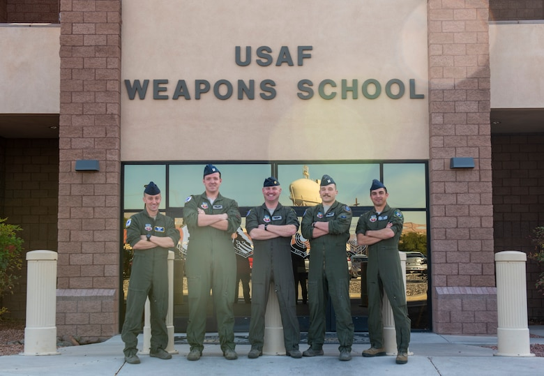 Pilots pose for a photo.