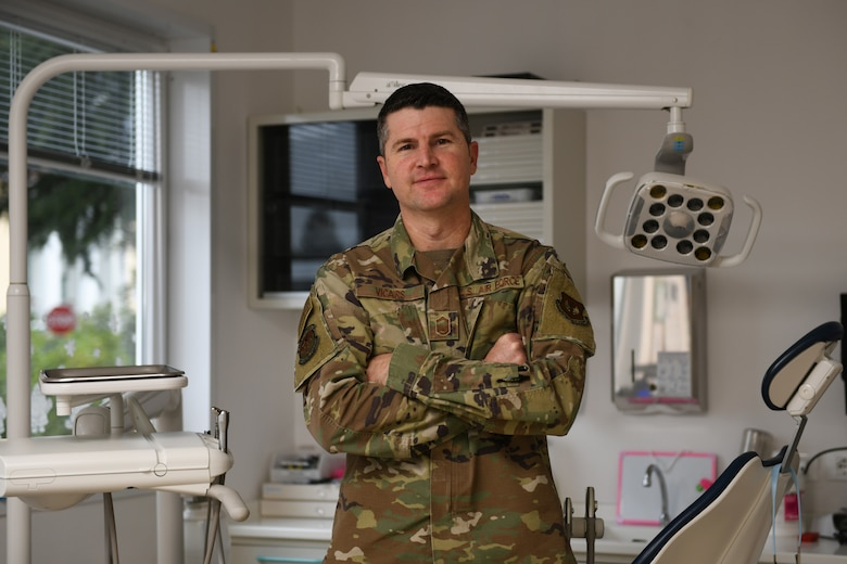 U.S. Air Force Senior Master Sgt. Jeffrey Vicars, superintendent of the 31st Dental Squadron, poses for a photo, Dec.18, 2019, at Aviano Air Base, Italy. The 31st Dental Squadron integrates community-based preventive dental services and utilizes all dental resources to enable peak mission readiness and sustained performance. (U.S. Air Force photo by Airman 1st Class Ericka A. Woolever).