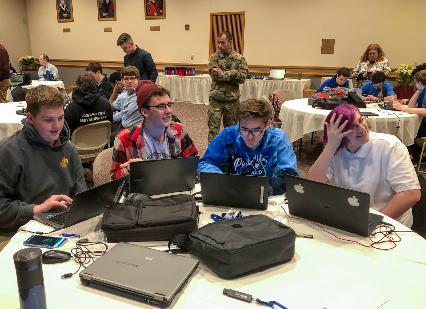 Soldiers with the Pennsylvania National Guard Cyber Branch and Recruiting and Retention Battalion engaged a group of 18 high school students in the new Wi-Fighter cyber challenge Dec. 12 at DeSales University in Center Valley, Pa. The winning team from Monroe Career and Technical Institute from right to left is: Chase Blecker, Rocco Susinskas, Jordan McGrath, and Liam Travers.