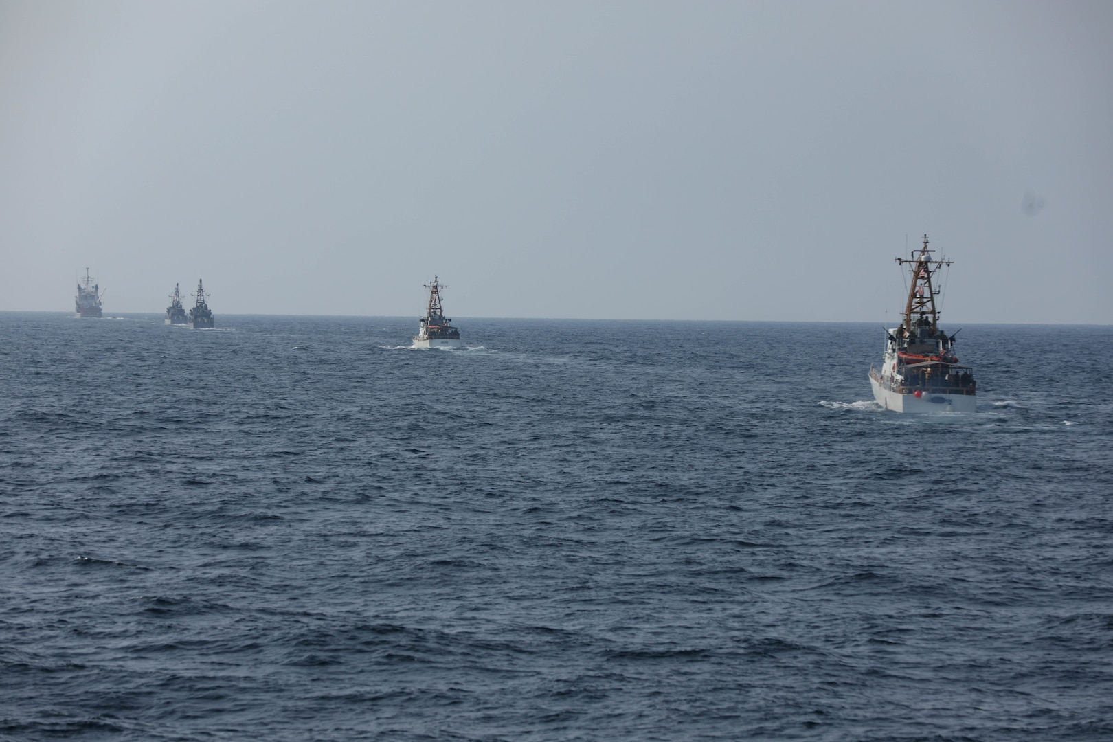 U.S. Navy and Coast Guard ships sail in formation, during Griffin Missile Exercise 19. The exercise demonstrated a proven capability for the ships to defend themselves against small boat threats and ensure maritime security through key chokepoints in the U.S. Central Command area of responsibility.