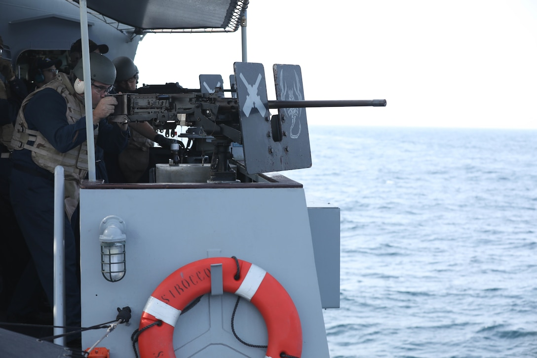 Boatswain's Mate 2nd Class Garner Jordan aims a M2 .50 Caliber machine gun at simulated enemy boats during Griffin Missile Exercise 19. The exercise demonstrated a proven capability for the ships to defend themselves against small boat threats and ensure maritime security through key chokepoints in the U.S. Central Command area of responsibility.
