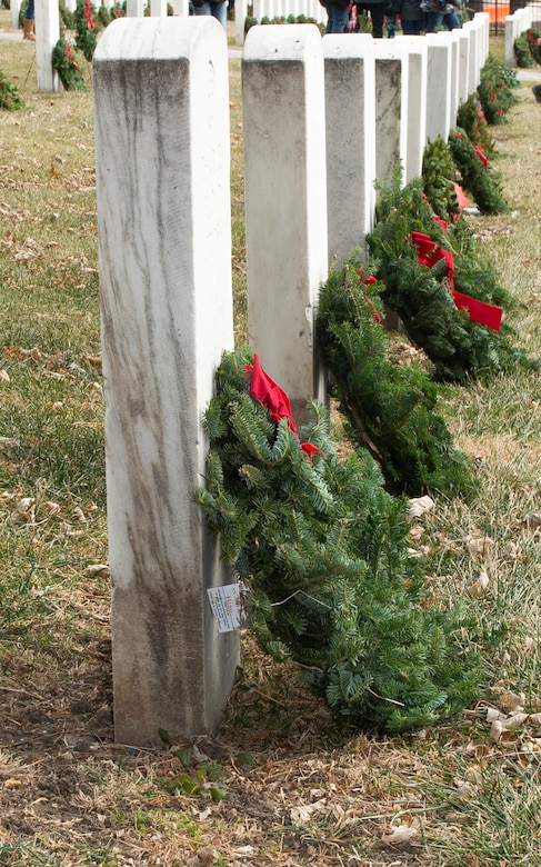Photo of wreaths leaning on a headstone at Offutt Air Force Base.