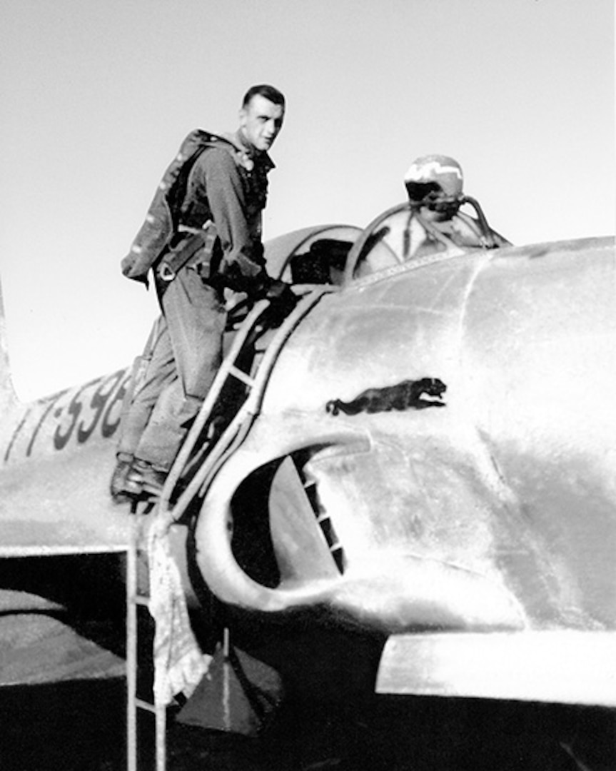 1st. Lt. Jerome Volk, seen at his F-80 Shooting Star fighter jet in October 1951 while deployed in support of the Korean War. Volk, the first Wisconsin Air National Guard pilot to die in the line of duty during the Korean conflict, was shot down during a combat sortie against communist forces Nov. 7, 1951, and his remains have never been recovered. In 1957 the Wisconsin Legislature renamed the portion of Camp Williams used by the Wisconsin Air National Guard as Volk Field.