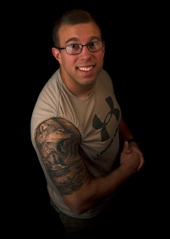 Photo of an Airman displaying a tattoo symbolizing his life perspective