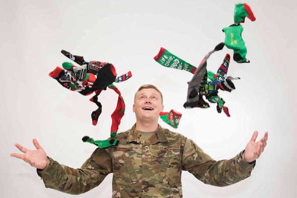 U.S. Air Force Staff Sgt. Eric Mann, 39th Air Base Wing Public Affairs broadcast journalist, celebrates after receiving a package of holiday socks Dec 12, 2019, at Incirlik Air Base, Turkey. Families and friends of troops stationed overseas commonly send gifts during the holiday season as a gesture to thank their loved ones for their service. (U.S. Air Force photo by Staff Sgt. Joshua Magbanua)
