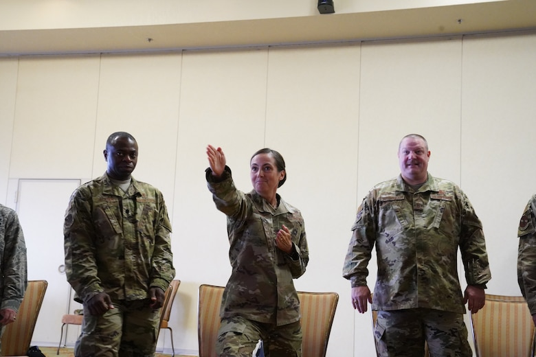 U.S. Air Force Col. Heather Blackwell, 81st Training Wing commander, Lt. Col. Norris Jackson, 81st Surgical Operations Squadron commander, and CMSgt. Charles Buterbaugh, 333rd Training Squadron superintendent, participate in an activity for the 'Improv to Improve' course in the Bay Breeze Event Center at Keesler Air Force Base, Mississippi, Dec. 10, 2019. Improv to Improve is an improvisation comedy resiliency class that engages military members in a safe interactive learning environment. The purpose of the class is to help combat life stress and adversity in an unconventional way. (U.S. Air Force photo by Airman 1st Class Spencer Tobler)