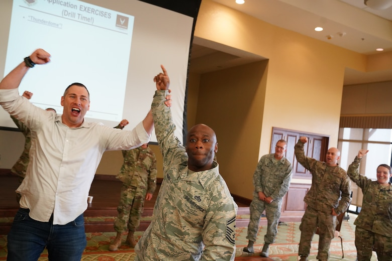Senior Master Sgt. Patrick Holmes, 335th Training Squadron first sergeant, participates in the Improv to Improve course in the Bay Breeze Event Center at Keesler Air Force Base, Mississippi, Dec. 10, 2019. Improv to Improve is an improvisation comedy resiliency class that engages military members in a safe interactive learning environment. The purpose of the class is to help combat life stress and adversity in an unconventional way. (U.S. Air Force photo by Airman 1st Class Spencer Tobler)