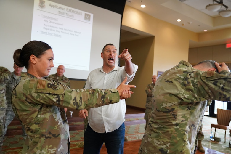 U.S. Air Force Col. Heather Blackwell, 81st Training Wing commander, BJ Lange, Wounded Warrior Project comedy coach participate in an activity for the 'Improv to Improve' course in the Bay Breeze Event Center at Keesler Air Force Base, Mississippi, Dec. 10, 2019. Improv to Improve is an improvisation comedy resiliency class that engages military members in a safe interactive learning environment. The purpose of the class is to help combat life stress and adversity in an unconventional way. (U.S. Air Force photo by Airman 1st Class Spencer Tobler)