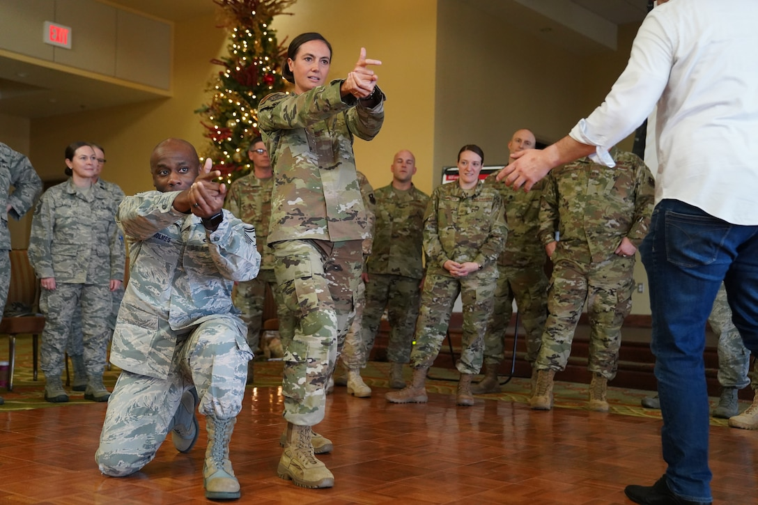 U.S. Air Force Col. Heather Blackwell, 81st Training Wing commander, and SMSgt. Patrick Holmes, 335th Training Squadron first sergeant, participate in an activity for the 'Improv to Improve' course in the Bay Breeze Event Center at Keesler Air Force Base, Mississippi, Dec. 10, 2019. Improv to Improve is an improvisation comedy resiliency class that engages military members in a safe interactive learning environment. The purpose of the class is to help combat life stress and adversity in an unconventional way. (U.S. Air Force photo by Airman 1st Class Spencer Tobler)
