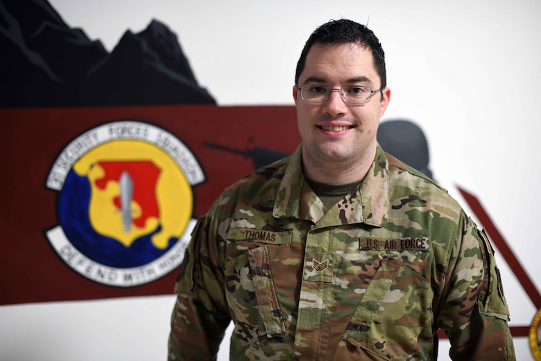 U.S. Air Force Staff Sgt. Keifer Thomas, a confinement NCO from the 31st Security Forces Squadron, poses for a photo at Aviano Air Base, Dec. 19, 2019.