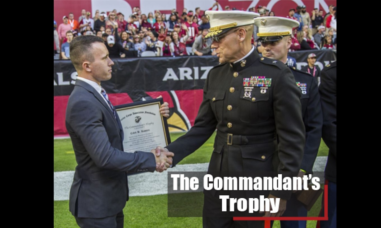 Candidate Caleb Ramirez, the honor graduate of Platoon Leaders Course Combined 20, was awarded the Marine Corps Commandants Trophy during the Arizona Cardinals' football game in Glendale, Arizona, on Dec. 1, 2019. Brigadier General Ryan P. Heritage, the commanding general of the Marine Corps Western Recruiting Region, presented the trophy to both Ramirez and the University of Arizona. The Platoon Leaders Course Combined is a 10-week training event designed to screen and evaluate potential Marine Corps Officers. Those who successfully complete the period of instruction are commissioned as Second Lieutenants in the United States Marine Corps.