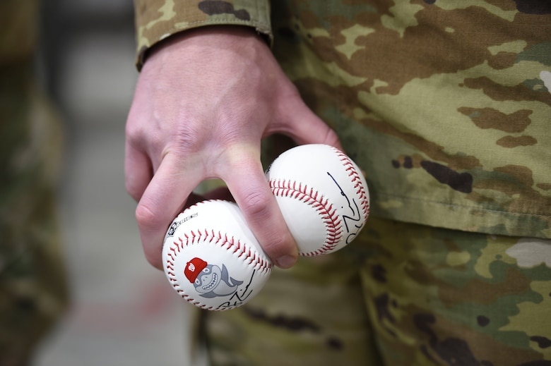 An Airman holds baseballs signed by Ryan Zimmerman, Washington Nationals first baseman, during a World Series trophy display event at Joint Base Andrews, Md., Dec. 17, 2019. Zimmerman and his wife toured sections of the base and showed off the trophy the Nationals won this year. (U.S. Air Force photo by Airman 1st Class Spencer Slocum)