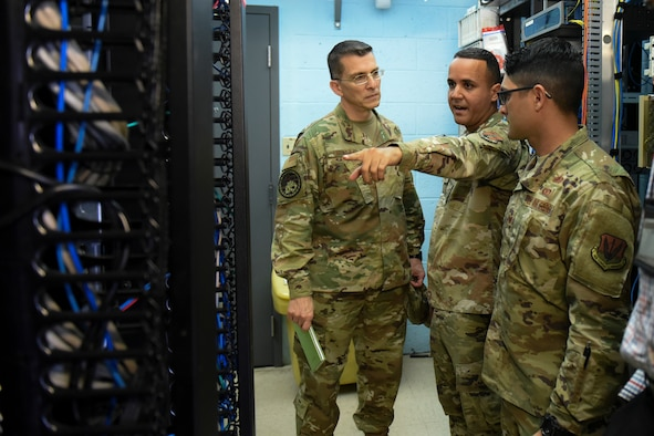 The National Guard Bureau's A/6 communications directorate team tours the network control center at the 156th Wing, Puerto Rico Air National Guard, Dec. 10, 2019, to assess and finalize plans to move the NCC after the building it's in was severely damaged by Hurricane Maria in 2017.