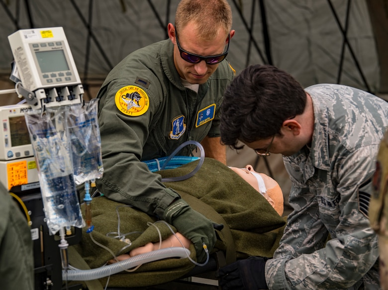 Airmen assigned to the 167th Medical Group, Martinsburg, West Virginia, secures a simulated patient during a casualty evacuation training for Sentry Storm 19 held July 20, 2019, at the Raleigh County Memorial Airport. Sentry Storm is a joint exercise held in southern West Virginia that offers military units real world training while providing domestic rapid response capabilities to support the World Scout Jamboree. (U.S. Air National Guard photo illustration by Master Sgt. De-Juan Haley)
