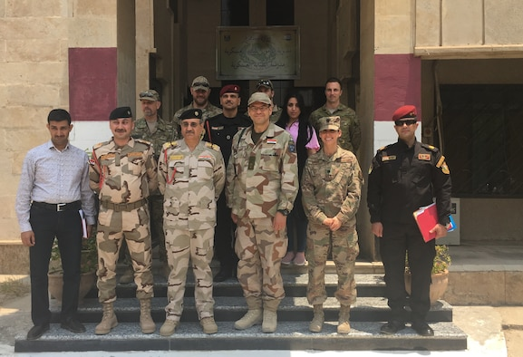 U.S. Air Force Lt. Col. Jessica Cowden, Infectious Disease Programs chief with the Defense Institute for Medical Operations, Joint Base San Antonio-Lackland, Texas, poses for a photo with the NATO Mission Iraq Embedded Training Team during the Combined Joint Task Force - Operation Inherent Resolve, June 25, 2019. The team, which included military members from Iraq, Australia, and Denmark, participated in a meeting to discuss standardized combat lifesaver training and standard equipment lists for training. Cowden deployed as an International Health Specialist, providing a foundation for improved medical security cooperation in Iraq. (Courtesy photo)