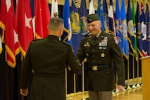 Two male Soldiers shake hands