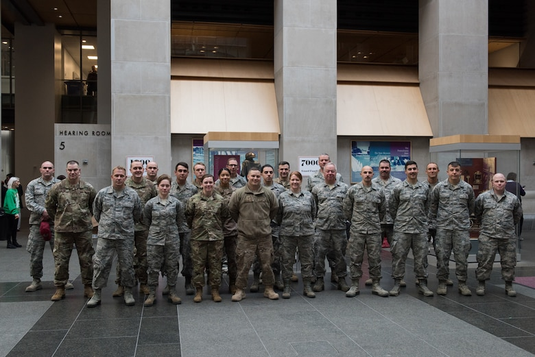 U.S. Airmen from the 193rd Special Operations Wing, Pennsylvania Air National Guard, gather together during the 30th Annual Holiday Wish Program.