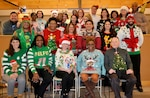 Employees pose for a photo during the Medical Culture Improvement Team's Ugly Holiday Sweater Day contest at DLA Troop Support Dec. 17, 2019 in Philadelphia.