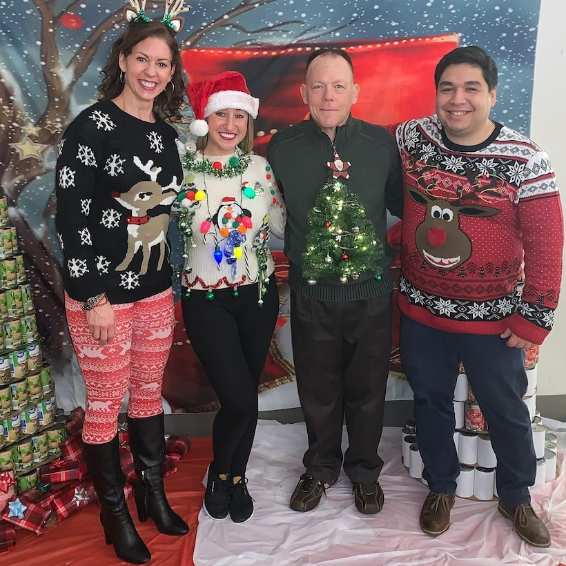 Medical employees pose for a photo during the Medical Culture Improvement Team Ugly Holiday Sweater Day at DLA Troop Support Dec. 17, 2019 in Philadelphia.