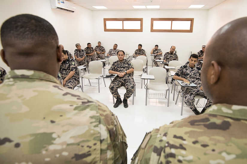 Students sit in a classroom.